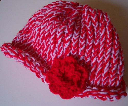 Red and white hat with flower