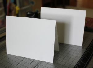 Folding notecards in half